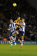 Hull city's Jake Livermore © is squeezed out by Chris Brunt (l) and James Morrison ® of West Brom. Barclays Premier league, West Bromwich Albion v Hull city at the Hawthorns in West Bromwich, England on Saturday 21st Dec 2013. pic by Andrew Orchard, Andrew Orchard sports photography.