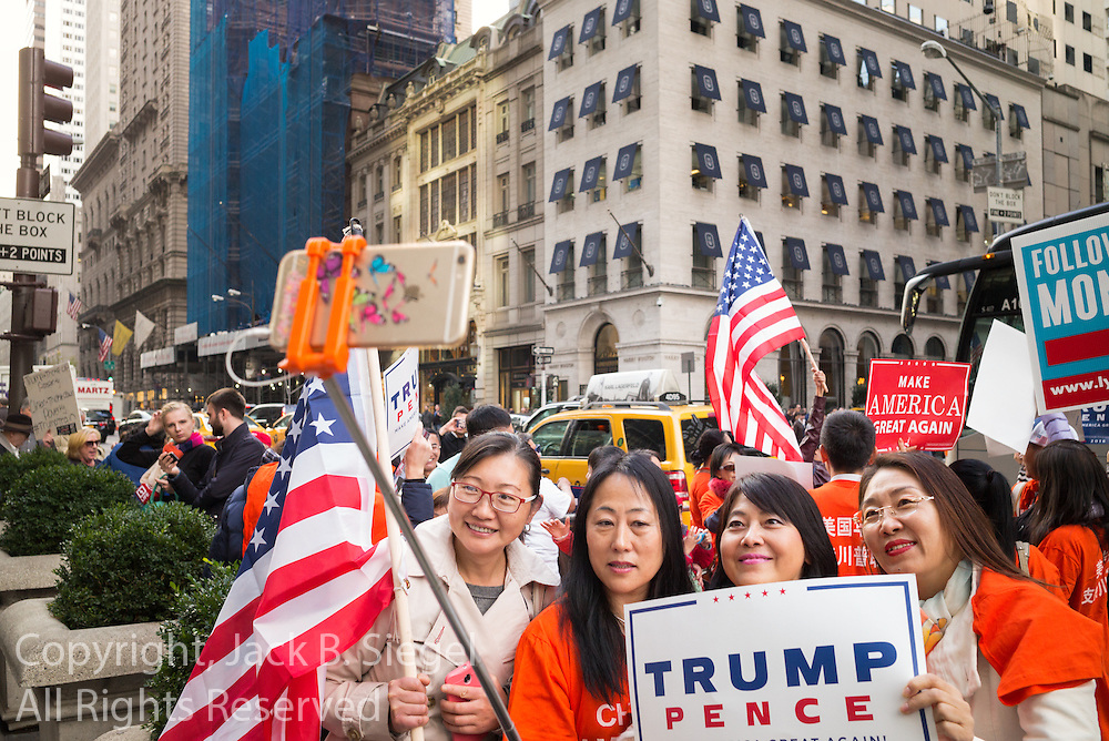 Four women taking a selfie at a gathering on New York's Fifth Avenue in front of Trump Tower the Saturday before the November 2017 election