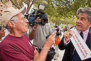 22 JULY 2010 -- PHOENIX, AZ: Jerry Harris (CQ) LEFT, a supporter of 1070 from Scottsdale and George Clifton (CQ) opposed to 1070, argue in front of the courthouse. Thousands of people came to the Sandra Day O'Connor United States Courthouse (CQ) in downtown Phoenix Thursday. PHOTO BY JACK KURTZ