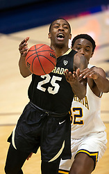 Feb 13, 2021; Berkeley, California, USA; Colorado Buffaloes guard McKinley Wright IV (25) loses the ball as he's defended by California Golden Bears guard Jalen Celestine (32) during the second half of an NCAA basketball game at Haas Pavilion. Mandatory Credit: D. Ross Cameron-USA TODAY Sports