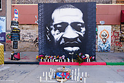 """02 APRIL 2021 - MINNEAPOLIS, MINNESOTA: A portrait of George Floyd at """"George Floyd Square"""", the Minneapolis intersection where George Floyd died while restrained and in police custody. Protesters are keeping a 24 hour presence in front of the Hennepin County Courthouse in Minneapolis during the murder trial of former Minneapolis Police Officer Derek Chauvin. Chauvin is on trial for murdering George Floyd in 2020. Floyd's death, while in police custody, set off a summer of racial justice protests across the United States.       PHOTO BY JACK KURTZ"""