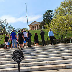 Washington, DC, USA - April 11, 2013: Visitors at President Kennedy's grave in Arlington National Cemetery in Virginia.