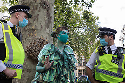 London, UK. 6th September, 2020. A climate activist from the Ocean Rebellion and Extinction Rebellion prepares to take part in a colourful Marine Extinction March. The activists, who are attending a series of September Rebellion protests around the UK, are demanding environmental protections for the oceans and calling for an end to global governmental inaction to save the seas.