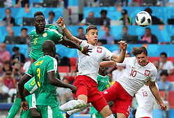 MOSCOW, June 19, 2018  Grzegorz Krychowiak (R top) of Poland heads to score during a Group H match between Poland and Senegal at the 2018 FIFA World Cup in Moscow, Russia, June 19, 2018. Senegal won 2-1. (Credit Image: © Ye Pingfan/Xinhua via ZUMA Wire)
