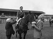 "07/08/1980<br /> 08/07/1980<br /> 07 August 1980<br /> R.D.S. Horse Show: John Player Top Score Competition, Ballsbridge, Dublin.  Harvey Smith (Great Britain) winner, on ""Sanyo Music Centre"" being congratulated by the President of the R.D.S. Professor John Carroll (Left) and receiving the winners rosette from Oliver Casey, Managing Director, John Player."
