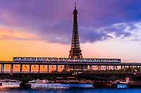 A Metro train crosses the RIver Seine over the Bir Hakeim Bridge, Paris, France.