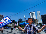 16 JUNE 2018 - SEOUL, SOUTH KOREA: A Korean evangelical Christian prays before a protest against South Korean President Moon Jae-in. He said he supports jailed former President Park Geun-hye. Moon was elected in 2017 after Park was impeached, tried and convicted on corruption charges. The protesters allege that Moon is too soft on North Korea and can't be trusted to negotiate with North Korean leader Kim Jong-un. They support US President Donald Trump's efforts to negotiate with the North Korean strongman.   PHOTO BY JACK KURTZ