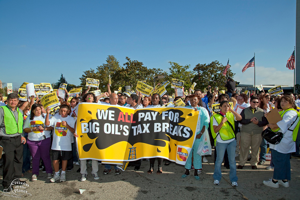 On July 22, 2010, over a thousand protesters marched to Occidental Petroleum offices in Westwood, Los Angeles to demonstrate against the California state loophole that allows oil companies to extract oil, tax free. Of the major oil producing states, only California does not have an oil severance tax on the million barrels of crude that are extracted from California lands and waters each year, money that is much needed revenue for the state's budget shortfall. Many people feel the oil tax could amount to over $1 billion and could offset proposed major budget spending cuts and job losses. Los Angeles, California, USA.