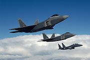 © F/A-22As with F-15E
