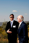 GE Energy Financial Services managing director Kevin Walsh talks with U.S. ambassador to the Portugal, Alfred Hoffman