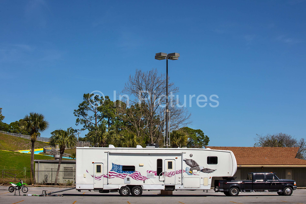 Huge caravan in carpark on 6th March 2020 in Panama City, Florida, United States. With an average of 320 days of Florida sunshine each year – and 27 miles of sugar-white sands bordering the clear, emerald green waters where the Gulf of Mexico and St. Andrew Bay converge – Panama City Beach is a favourite of travellers seeking an affordable beach vacation with year round offerings.