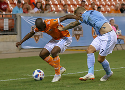 July 18, 2018 - Houston, TX, U.S. - HOUSTON, TX - JULY 18:  Houston Dynamo midfielder Oscar Garcia (27) tries to keep the ball away from Sporting Kansas City forward Johnny Russell (7) during the US Open Cup Quarterfinal soccer match between Sporting KC and Houston Dynamo on July 18, 2018 at BBVA Compass Stadium in Houston, Texas. (Photo by Leslie Plaza Johnson/Icon Sportswire) (Credit Image: © Leslie Plaza Johnson/Icon SMI via ZUMA Press)
