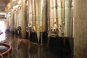 The vat hall with stainless steel fermentation tanks, each with its own name: Hercule (Hercules), Neptune... Chateau Romanin, Saint Remy de Provence, Bouches du Rhone, Provence, France, Europe