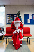 Santa arrives to visit the children of prisoners families inside the visitors centre. HMP/YOI Portland, a resettlement prison with a capacity for 530 prisoners. Dorset, United Kingdom.