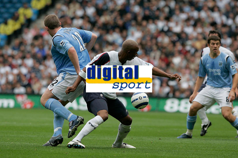 Photo: Dave Howarth.<br />Manchester City v Bolton Wanderers. The Barclays Premiership. 18/09/2005. El Hajif Diouf under preasure from Darius Vassell
