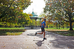 ©Licensed to London News Pictures 14/10/2020  <br /> Greenwich, UK. A runner enjoying the sun running passed the bandstand. Autumn sunshine makes a brief appearance today in Greenwich park, Greenwich, London. Photo credit:Grant Falvey/LNP
