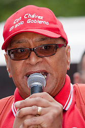 London, June 21st 2014. Black rights campaigner Lee Jasper addresses the crowd prior to the march Against Austerity setting off.