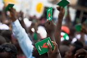 Convention People's Party (CPP) supporters hold up their membership cards during a rally in Accra, Ghana on Sunday September 21, 2008.