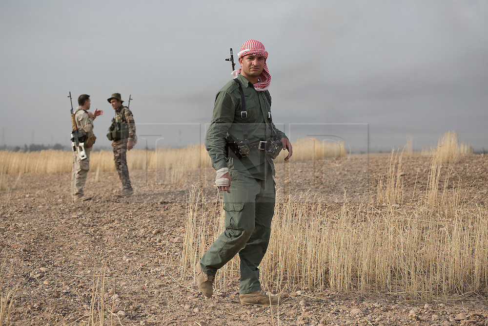 © Licensed to London News Pictures. 30/09/2015. Kirkuk, Iraq. Kurdish peshmerga sharp shooters are seen on a hill during an offensive aimed at capturing 11 villages from the Islamic State near Kirkuk, Iraq.<br /> <br /> Supported by large amounts of coalition airstrikes, members of the Iraqi-Kurdish peshmerga today (30/09/2015) took part in an offensive to take seven villages across a large front near Kirkuk, Iraq. By mid afternoon the Kurds had reached most of their objectives, but suffered around 10 casualties all to improvised explosive devices. All seven villages were originally Kurdish and settled with other ethnic groups during the Iraqi Arabisation process of the 1970's and 80's. Photo credit: Matt Cetti-Roberts/LNP