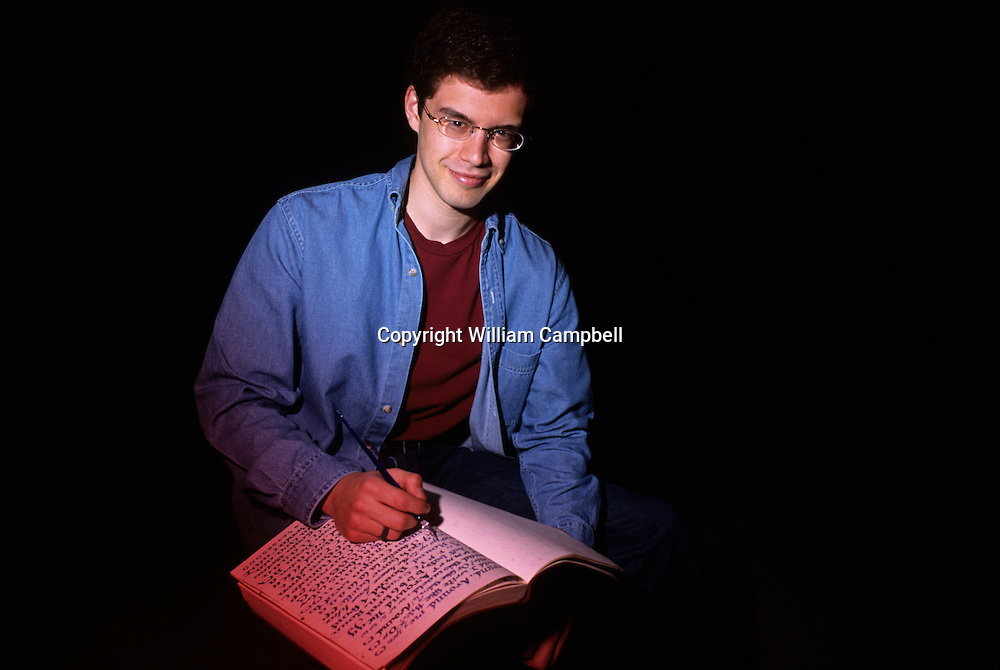 Christopher Paolini, author of bestselling fantasy books Eragon and the 2005 sequel Eldest in Montana, USA. With the caligraphy and lanquage he created for the books.
