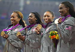 11.08.2012, Olympia Stadion, London, GBR, Olympia 2012, 4 x 400m Staffel, Damen, Podium, im Bild gold Medaille Team USA DeeDee Trotter (USA), Allyson Felix (USA), Francena Mccorory (USA), Sanya Richards-Ross (USA)  // gold medal Team USA DeeDee Trotter (USA), Allyson Felix (USA), Francena Mccorory (USA), Sanya Richards-Ross (USA) during Women's 4 x 400m Relay Podium at the 2012 Summer Olympics at Olympic Stadium, London, United Kingdom on 2012/08/11. EXPA Pictures © 2012, PhotoCredit: EXPA/ Johann Groder