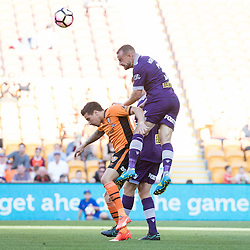 BRISBANE, AUSTRALIA - OCTOBER 30: Marc Warren of the Glory heads the ball over Jamie MacLaren of the roar during the round 4 Hyundai A-League match between the Brisbane Roar and Perth Glory at Suncorp Stadium on October 30, 2016 in Brisbane, Australia. (Photo by Patrick Kearney/Brisbane Roar)