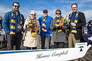 Luke Campbell, left,  Sheila Campbell, Howard (Howie) Campbell, Marilyn Campbell and Clint Hamilton celebrated the boat christening prior to the annual Brown Cup regatta between the University of Victoria and University of British Columbia at the Gorge Waterway in Victoria, British Columbia Canada on March 25, 2017.