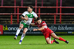 11th November 2018 , Racecourse Ground,  Wrexham, Wales ;  Rugby League World Cup Qualifier,Wales v Ireland ; Scott Grix of Ireland evades the tackle of James Olds of Wales <br /> <br /> <br /> Credit:   Craig Thomas/Replay Images