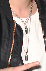 EXCLUSIVE: Kristen Stewart fashioned a patriotic headband as she flashed the peace sign in the snowy weather in Park City, Utah. The Twilight actress was spotted in Park City, Utah wearing the red, white and blue headband ahead of the Presidential inauguration. She was also pictured with two male friends walking in front of her. Kristen flashed the peace sign fashioning a stylish, casual look at the Prospector Square Theater showing off her Jillian Dempsey's Punk Lock Necklaces worth $1750. The 26 year old actress also fashioned black leather motorcycle jacket over a white undershirt and torn grey jeans paired with vintage Adidas sneakers. Kristen Stewart is in Park City, Utah, premiering Come Swim, the short film that marks her directorial and screenwriting debut. 19 Jan 2017 Pictured: Kristen Stewart. Photo credit: Atlantic Images / MEGA TheMegaAgency.com +1 888 505 6342