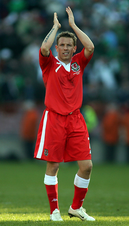 Photo: Paul Thomas.<br /> Republic of Ireland v Wales. European Championships 2008 Qualifying. 24/03/2007.<br /> <br /> Craig Bellamy of Wales thanks their fans.