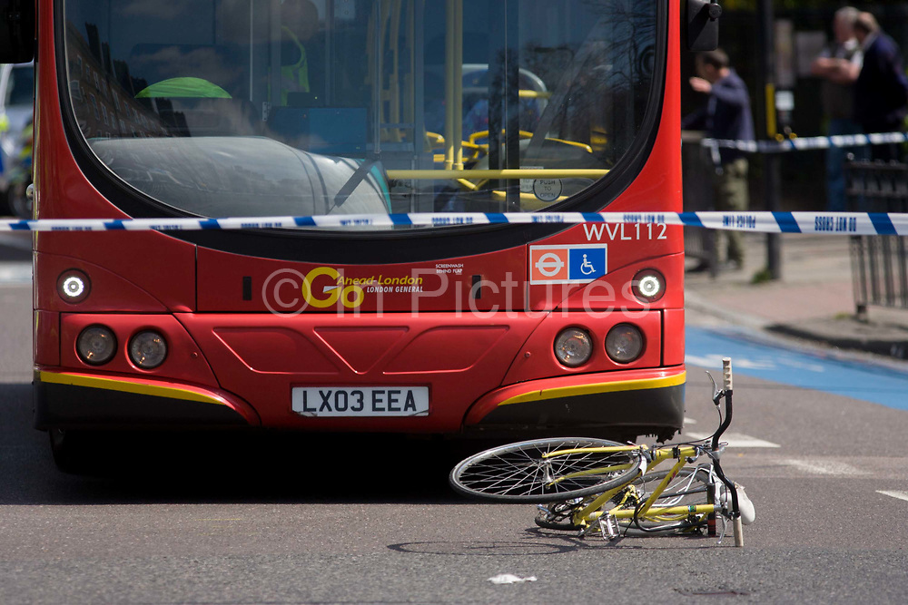 """The crushed wreckage of a ladies bike lies on the surface of the A3 Kennington Park Road at the junction with A23 Kennington Road, south London. A woman in her twenties was taken to King's College Hospital with a leg injury after a crash between a bus and a cyclist this morning. Emergency services were called to Kennington Park Road at 9.30am. A London Buses statement reads: """"At around 09:30 this morning a route 333 bus, operated by London General, was involved in a collision with a cyclist .."""""""