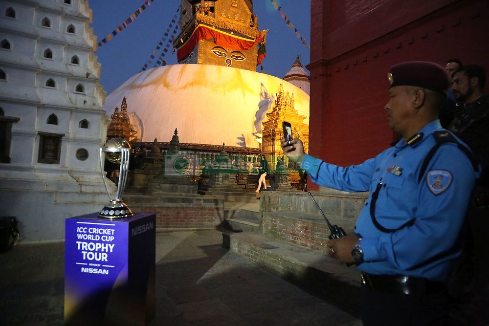 KATHMANDU, Oct. 26, 2018  A Police personnel takes photo of the ICC(International Cricket Council) World Cup trophy as it has arrived for the ICC  Cricket World Cup Trophy Tour at Swaymbhu in Kathmandu, Nepal, Oct. 26, 2018. (Credit Image: © Sunil Sharma/Xinhua via ZUMA Wire)