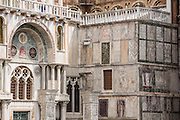 """The façade of Saint Mark's Basilica is like a patchwork quilt made of marble. In Venice, Italy, the Byzantine architecture of Saint Mark's Basilica dates from 1063 AD. Basilica Cattedrale Patriarcale di San Marco is the cathedral church of the Roman Catholic Archdiocese of Venice. Piazza San Marco (Saint Mark's Square) is the prime walking center of Venice. The Piazzetta extends Piazza San Marco to the Venetian Lagoon waterfront. Venice (Venezia) is the capital of Italy's Veneto region, named for the ancient Veneti people from the 900s BC. The romantic """"City of Canals"""" stretches across 100+ small islands in the marshy Venetian Lagoon along the Adriatic Sea. The Republic of Venice wielded major sea power during the Middle Ages, Crusades, and Renaissance. Riches from Venice's silk, grain, and spice trade in the 1200s to 1600s built elaborate architecture combining Gothic, Byzantine, and Arab styles. Venice and the Venetian Lagoons are honored on UNESCO's World Heritage List."""