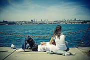 Turkish boyfriend and girlfriend take a rest on the Bosphorus coast in Kadikoy district in Istanbul, Turkey, June 15, 2009.<br /> <br /> This image is part of the series 'Bos-for-Us: Daily life on Istanbul Bosphorus'.<br /> <br /> © Giorgio Perottino