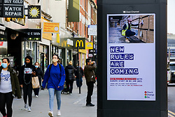 © Licensed to London News Pictures. 19/10/2020. London, UK. Shoppers in north London walk past the government's publicity campaign 'NEW RULES ARE COMING' for firms that trade with Europe to prepare for a no-deal Brexit. HMRC will contact over 200,000 firms that trade with the EU to set out the new customs and tax rules and how to deal with them. Photo credit: Dinendra Haria/LNP