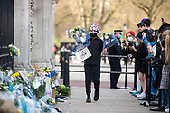 A Royal Family fan lays flowers In memory of Prince Philip The Royal Highness the Duke of Edinburgh, London on 9 April 2021.