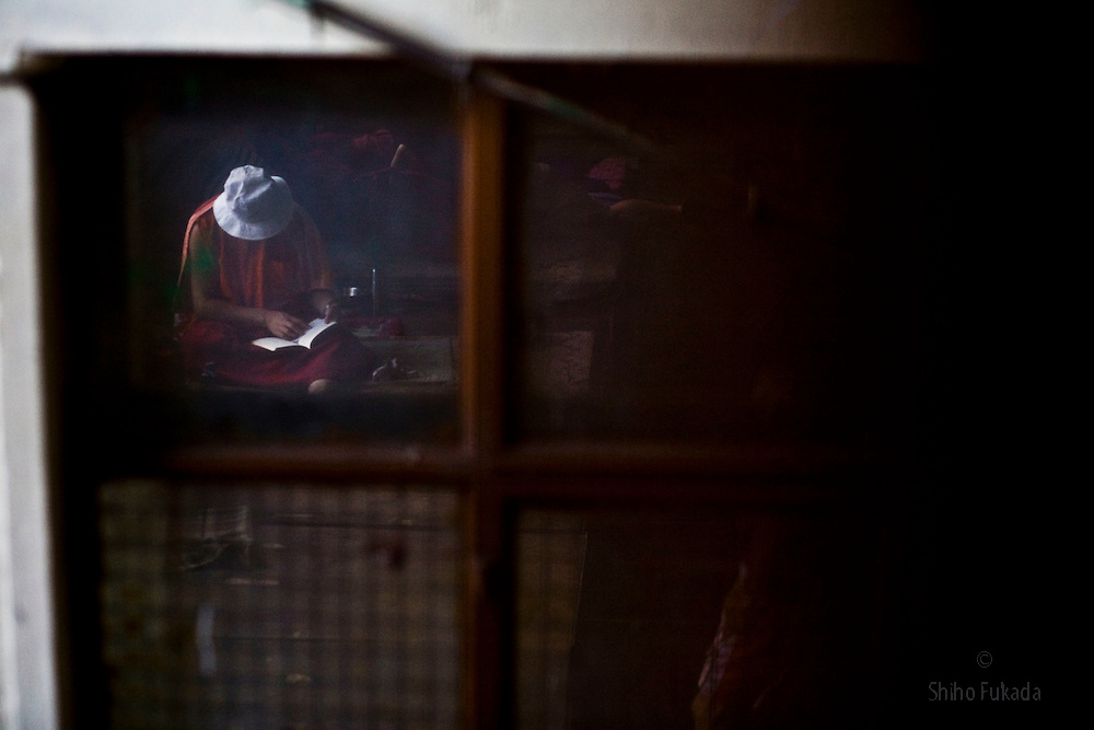 A monk studies at Reception Center, a temporary shelter for newly arrived Tibetan refugees in McLeod Ganj, Dharamsala, India, where the Dalai Lama settled after fleeing Tibet in 1959 after a failed uprising against Chinese rule, June 3, 2009.
