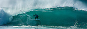 Surfer deep in the tube <br /> at Pipeline on Oahu's North Shore, Hawaii