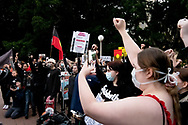Protesters hold up signs in Hyde Park during a 'Black Lives Matter' rally on 02 June, 2020 in Sydney, Australia. This event was organised to rally against aboriginal deaths in custody in Australia as well as in unity with protests across the United States following the killing of an unarmed black man George Floyd at the hands of a police officer in Minneapolis, Minnesota. (Photo by Lucca Markham/ Speed Media)