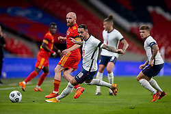 LONDON, ENGLAND - Thursday, October 8, 2020: England's Danny Ings (C) and Wales' Jonathan Williams during the International Friendly match between England and Wales at Wembley Stadium. The game was played behind closed doors due to the UK Government's social distancing laws prohibiting supporters from attending events inside stadiums as a result of the Coronavirus Pandemic. England won 3-0. (Pic by David Rawcliffe/Propaganda)