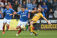 Luke Berry of Cambridge United tackles Gary Roberts of Portsmouth. Skybet football league two match, Cambridge Utd v Portsmouth at the Abbey Stadium  in Cambridge on Saturday 10th October 2015.<br /> pic by John Patrick Fletcher, Andrew Orchard sports photography.