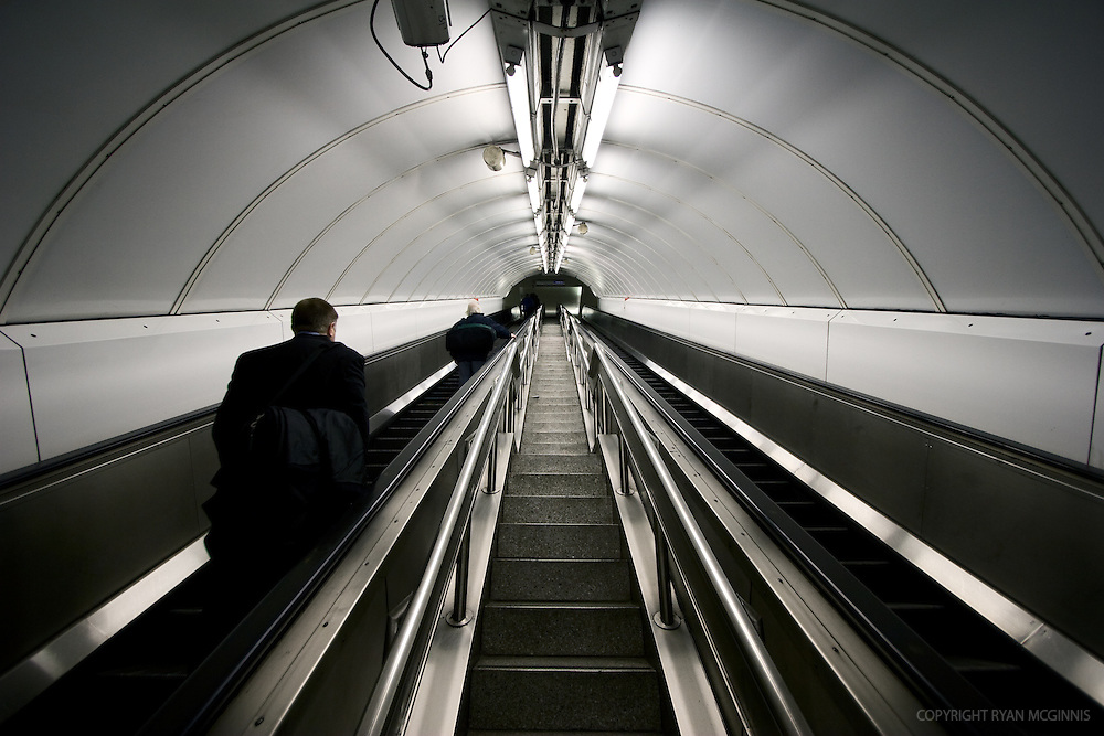 A man scales the tube escalator in London, UK, December 5, 2007.