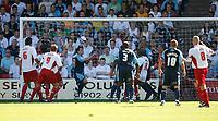 Photo: Steve Bond.<br />Walsall v Swansea City. Coca Cola League 1. 25/08/2007. Leon Britton (left centre) clears off his own goal line