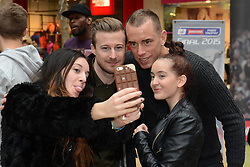 A Bristol City fans takes a selfie with Bristol City's Wade Elliott and Bristol City's Aaron Wilbraham - Photo mandatory by-line: Dougie Allward/JMP - Mobile: 07966 386802 - 11/03/2015 - SPORT - Football - Bristol - Cabot Circus Shopping Centre - Johnstone's Paint Trophy