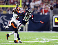 Houston Texans wide receiver DeAndre Hopkins (10) reaches for a pass as Cincinnati Bengals cornerback Adam Jones (24) defends during the second half of an NFL football game Saturday, Dec. 24, 2016, in Houston. (AP Photo/Sam Craft)