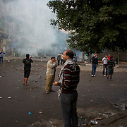 Egyptian protestors disperse from a road near Tahrir Square in Cairo, after a tear gas attack by the security forces.