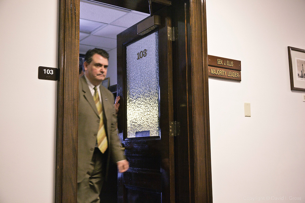 Senator Johnny Ellis (R), the Alaska state Senate Majority Leader, leaves his office after meeting with Rep. Chris Tuck (D) to discuss Tuck's bill.