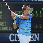 Borna Coric, Croatia, in action against Thanasi Kokkinakis, Australia, during the Junior Boys' Singles Final at the US Open. Flushing. New York, USA. 8th September 2013. Photo Tim Clayton