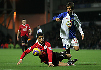 Photo: Paul Thomas.<br /> Blackburn Rovers v Manchester United. The Barclays Premiership. 11/11/2006.<br /> <br /> Man Utd's Cristiano Ronaldo (L) is tackled by Morten Gamst Pedersen.