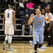 East Carteret's Trevor Willis celebrates winning the Leon Brogden Holiday Basketball Tournamnet. (Jason A. Frizzelle)